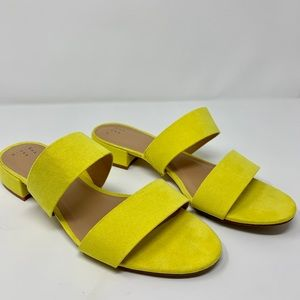 bright yellow slide-on sandals